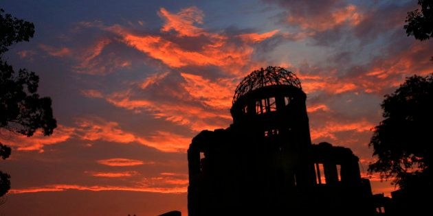 The Atomic Bomb Dome is silhouetted at sunset in Hiroshima, western Japan, Monday, Aug. 5, 2013. Hiroshima...