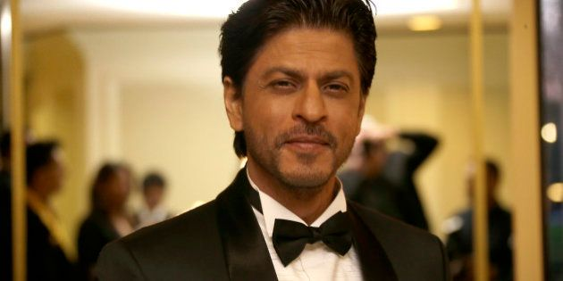 Shah Rukh Khan poses for photographers upon arrival at The Asian Awards in central London, Friday, 17...