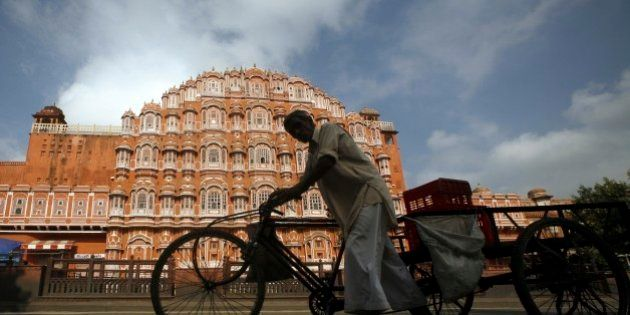 An Indian man pulls a rickshaw past the 'Hawa Mahal' or the Palace of Winds in Jaipur, India, Monday,...