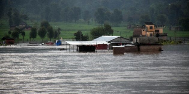 MANDI, INDIA - AUGUST 14: Flood in Sukheti river after heavy rains at Bahl Valley on August 14, 2014...