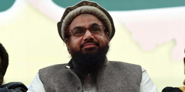Hafiz Muhammad Saeed (C), head of the banned Pakistani charity organisation, Jamaat-ud-Dawa (JuD) attends...