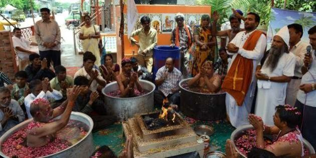 Indian Hindu Brahmins perform rituals to appease the Rain God on the outskirts of Ahmedabad on July 1,...