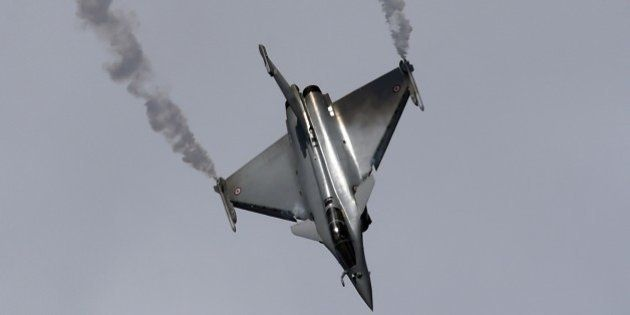 The Dassault Rafale fighter jet performs its flying display on the first public day at the International...