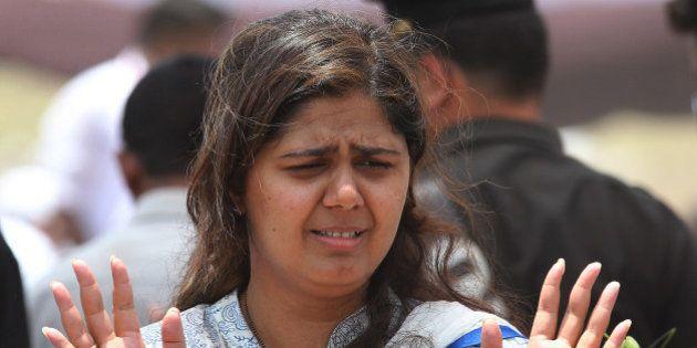 BEED, INDIA - JUNE 4: Daughter Pankaja Munde of late BJP leader Gopinath Munde during his funeral at...