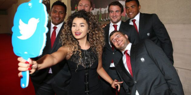 LONDON, ENGLAND - AUGUST 05: Ella Eyre takes a selfie with the Twitter mirror with players (L-R) Mako...