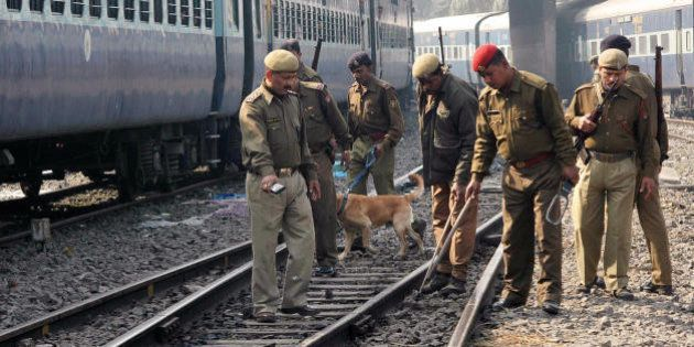 GUWAHAti, INDIA: Indian security personnels check the railway tracks near the Guwahati Railway station...
