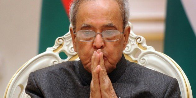 Indian President Pranab Mukherjee listens to his Belarus' counterpart during a signing ceremony at the...
