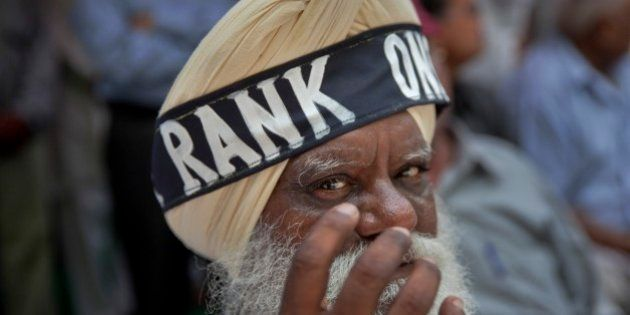 A former Sikh army soldier wears a headband around his turban during a protest in New Delhi, India, Sunday,...