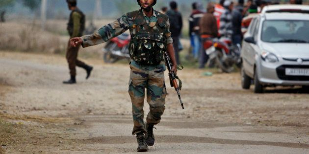 An Indian Army soldier gives orders to his colleagues during exchange of gunfire with armed suspected...