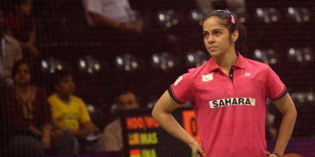 In this photograph taken on March 25, 2015, Saina Nehwal of India reacts during her women's badminton...
