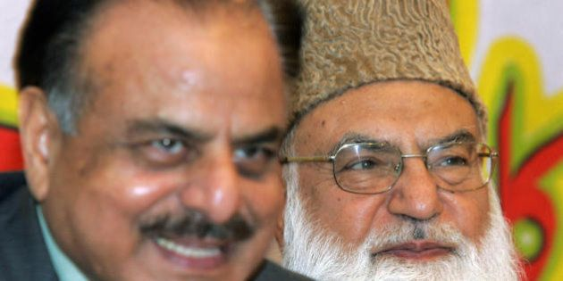 Leader of Pakistan?s hardline Muttahida Majlis-e-Amal (MMA) Qazi Hussain Ahmed (R) sits with former Inter...