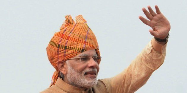 Indian Prime Minister Narendra Modi waves after delivering his Independence Day speech from The Red Fort...