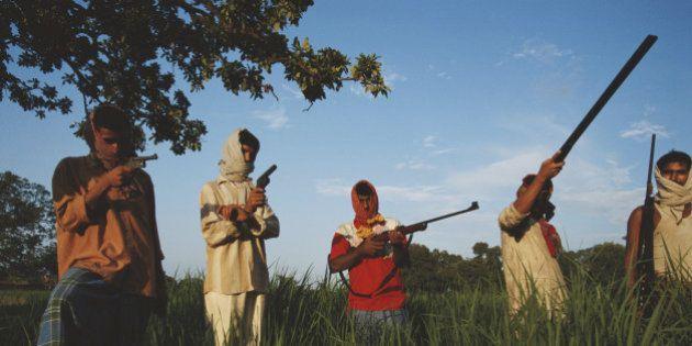 Members of the Ranvir Sena, an upper caste militia in Bihar, India, circa 1995. (Photo by Robert Nickelsberg/Getty