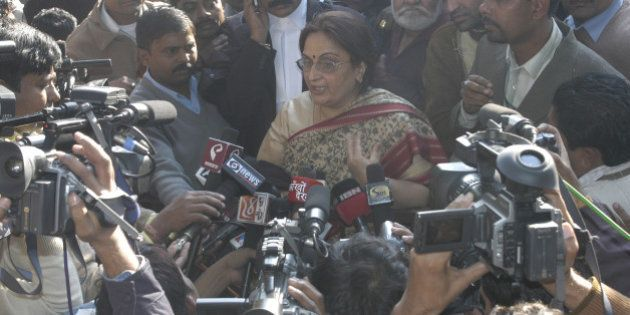 INDIA - DECEMBER 19: Neelam Katara, mother of Nitish Katara, speaks to media persons just after the court's...