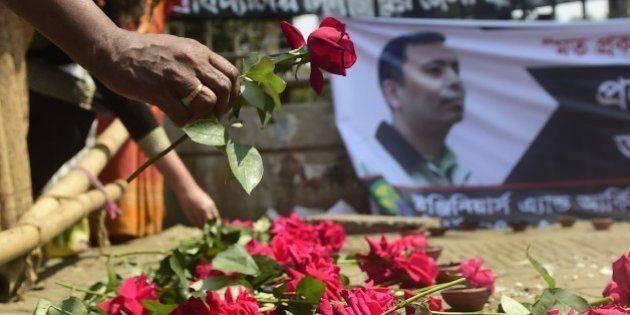 A Bangladeshi social activist pays his last respects to slain US blogger of Bangladeshi origin and founder...