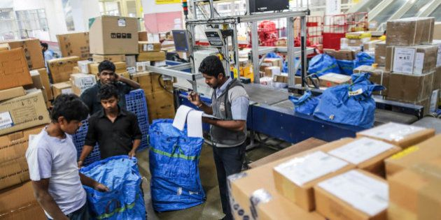Blue Dart Express Ltd. employees sort parcels during the overnight sort inside the company's joint hub...