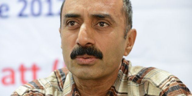IPS Sanjiv Bhatt gestures after receiving the 5th Mother Teresa Award for Social Justice in Ahmedabad...