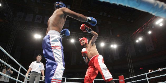 INCHEON, SOUTH KOREA - JULY 03: Thanh Tran (Red) of Vietnam compete with Kumar Visal (Blue) of India...