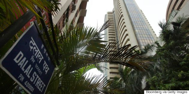 The Bombay Stock Exchange (BSE), right, stands on Dalal street in Mumbai, India, on Tuesday, June 18,...
