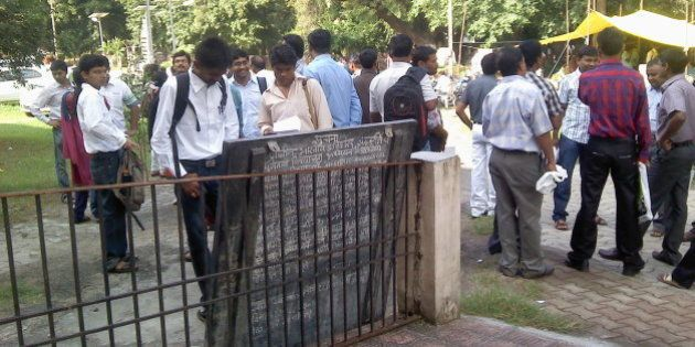 Candidates checking their roll numbers on the first day of MPSC State Services Main Examination 2012...
