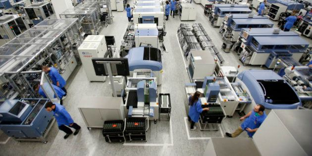The Siemens electronics manufacturing plant is photographedin Amberg, Germany, Monday, Feb. 23, 2015. (AP Photo/Michael Probst)