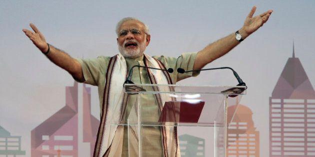 Indian Prime Minister Narendra Modi addresses Indian expatriates at a cricket stadium, Monday, Aug. 17,...