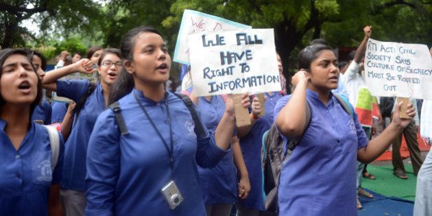 Indian activists shout slogans during a protest against the changes in the Right to Information (RTI)...
