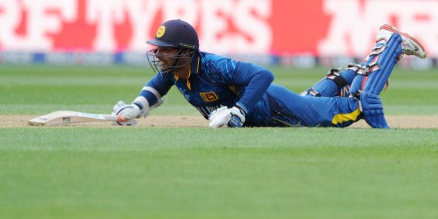 Sri Lanka's Kumar Sangakkara dives to make his ground against Engalnd during their Cricket World Cup...
