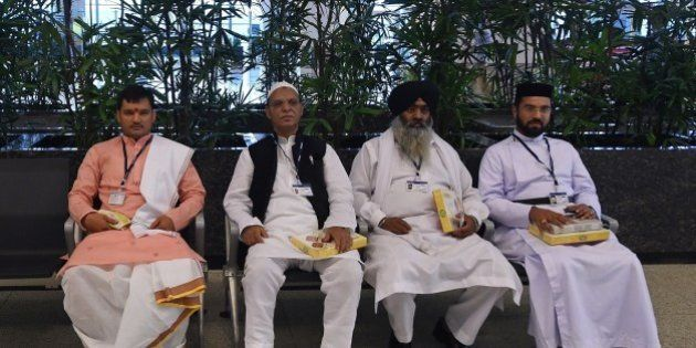 (From L-R) Indian Hindu, Muslim, Sikh, and Christian religious leaders sit together following prayer...