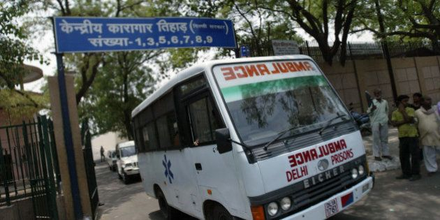A Prison ambulance leaves Asia's largest prison, Tihar Jail, where six inmates and one policeman have...