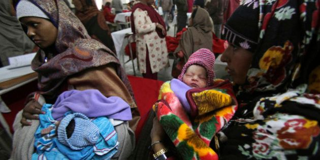 Indian mothers hold their babies, born on 12/12/12 at a hospital in Jammu, India, Wednesday, Dec. 12,...