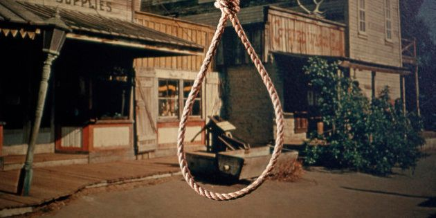 1960s ROPE HANGMAN NOOSE KNOT BACKGROUND OLD WEST COWBOY TOWN (Photo by H. Armstrong Roberts/ClassicStock/Getty