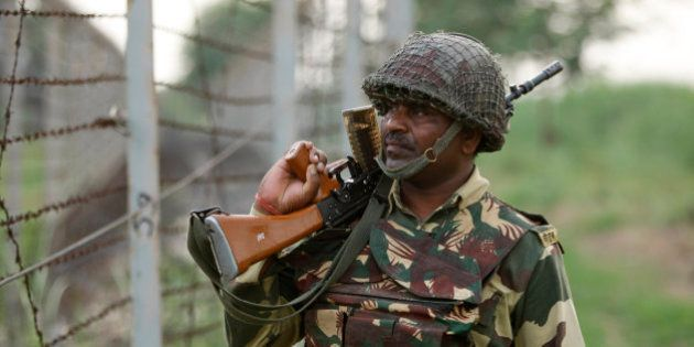 An Indian Border Security Force (BSF) soldier patrols along the Pargwal area of India-Pakistan international...