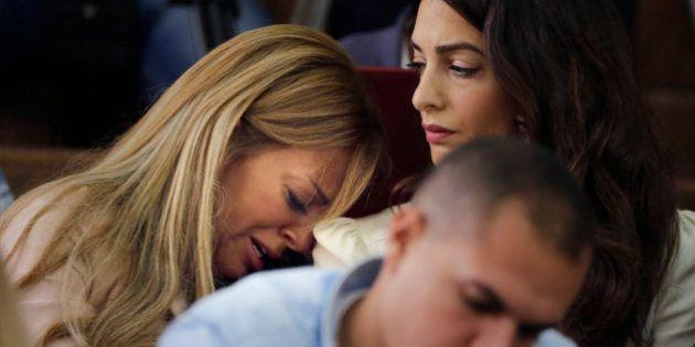 Marwa Fahmy wife of Canadian Al-Jazeera English journalist Mohammed Fahmy, bursts into tears, as she...