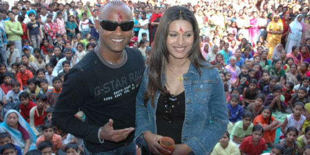 Former Indian Cricketer Vinod Kambli and his wife Andrea Hewaitt pose for photographs as they visit underprivileged...