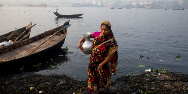 Women collected polluted water from Buriganga river for their daily needs, on February 23, 2015. A large...