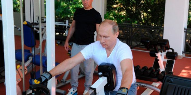 Russian President Vladimir Putin, foreground, and Prime Minister Dmitry Medvedev exercise during their...