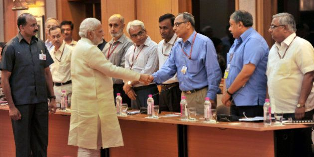 In this June 4, 2014 photo, Indian Prime Minister Narendra Modi, second left in front, interacts with...