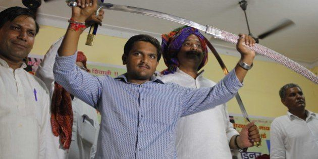 NEW DELHI, INDIA - AUGUST 30: Hardik Patel, Convener of Patidar Anamat Andolan Samiti (PAAS) being felicitated...