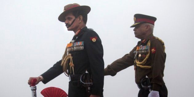 Indian Army Chief General Dalbir Singh Suhag, left, participates in a parade on the occasion of the Indian...