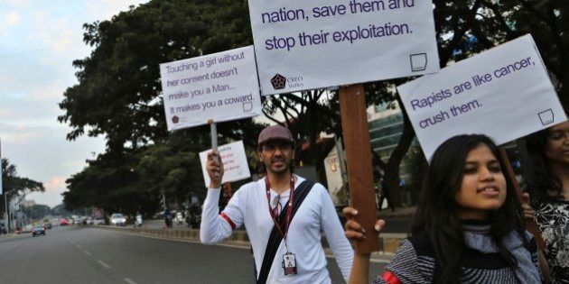 Indian students hold placards during an awareness campaign about safety of women in Bangalore, India,...