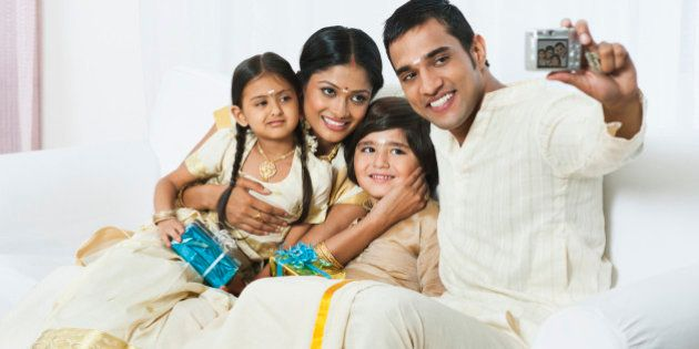 South Indian man taking a picture of his family at