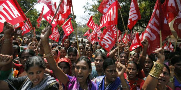 Indian workers participate in a rally on the first day of a two day strike in Hyderabad, India, Wednesday,...
