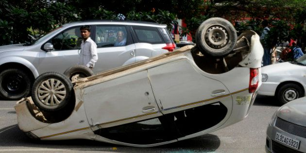GURGAON, INDIA - JULY 15: An Etios car turned over after accident with the Hyundai SUV car after it was...