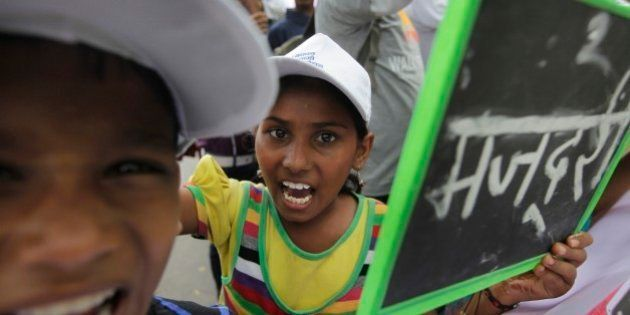 Indian children and freed child laborers participate in a march demanding the passage of the Child and...