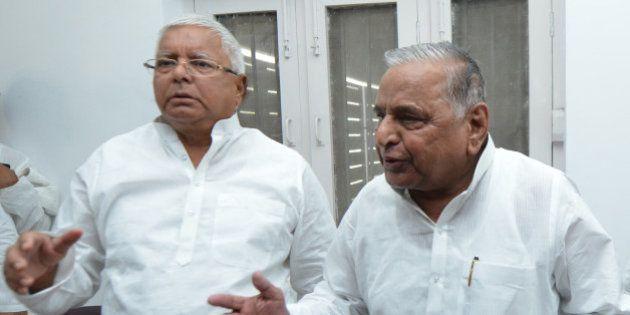NEW DELHI,INDIA JUNE 08: Samajwadi Party chief Mulayam Singh Yadav and RJD Chief Lalu Prasad Yadav after...