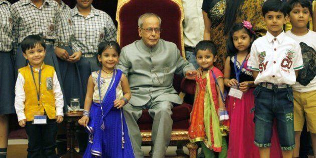 NEW DELHI, INDIA - AUGUST 29: President of India Pranab Mukherjee meeting the children on the auspicious...