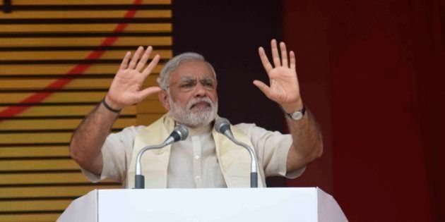 ARRAH, INDIA - AUGUST 18: Prime Minister Narendra Modi addresses a public rally on August 18, 2015 in...