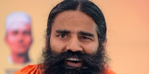 Indian yoga guru Baba Ramdev addresses a press conference in New Delhi on March 21, 2014. Ramdev will...