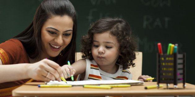 Teacher and schoolgirl (2-3) at